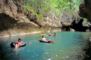 cave tubing and zip lining in belize